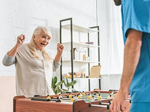 Old-Woman-Playing-Fussball